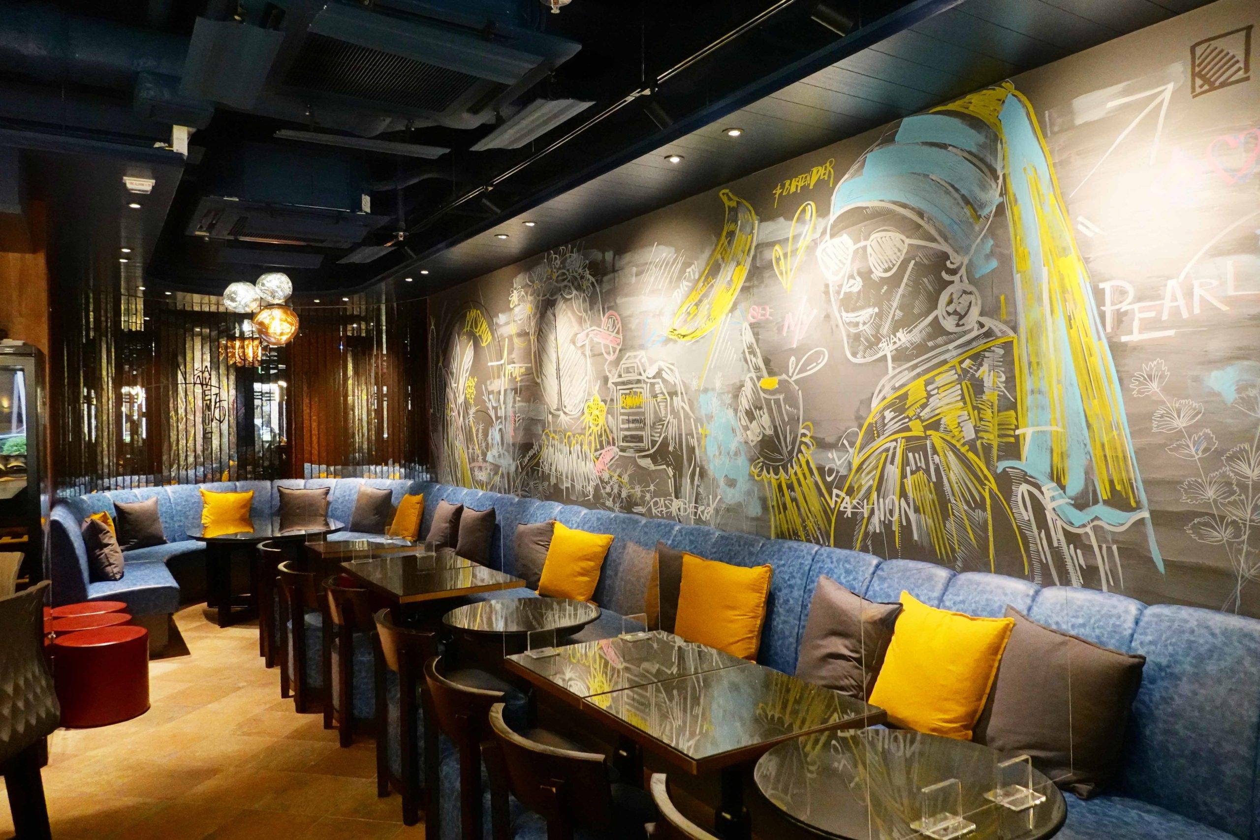 由調酒師Shane Siu親自繪畫嘅牆畫,非常型格。